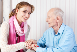 lady holding patient's hand
